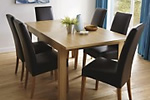Wood effect veneer dining table and leather dining chairs