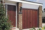 Preframed garage canopy door