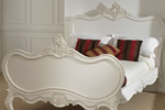 Antique French bed in cream