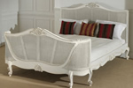 Antique French bed in white